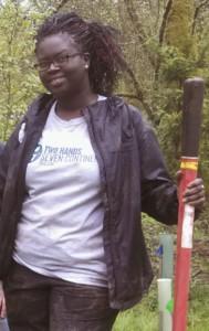 2H7C fundraising director, Ramou Sowe providing volunteer service