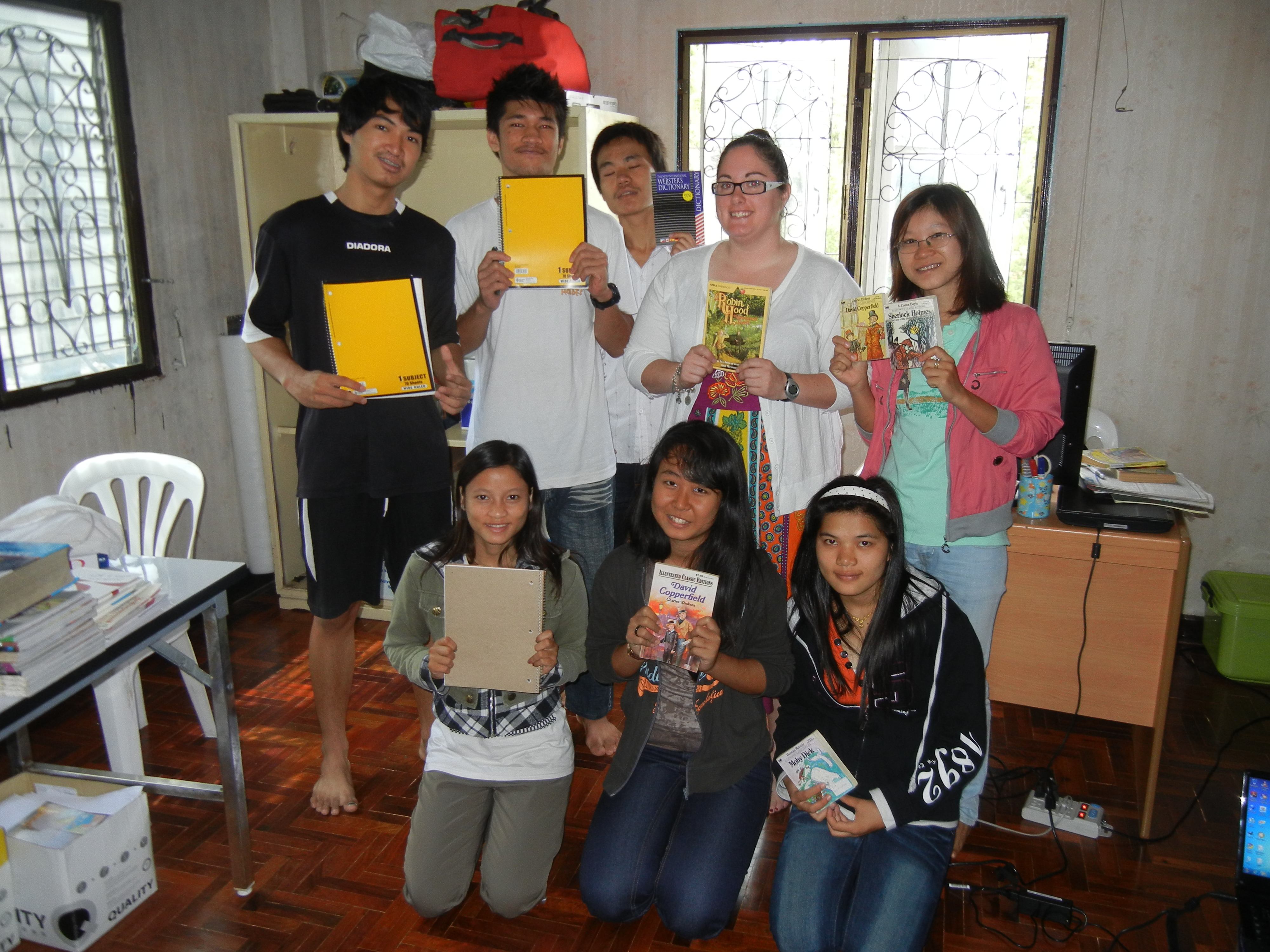 Crystal handing out school supplies to Burmese students in Thailand.