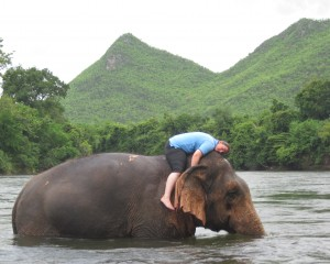 Crystal laying on Kammoon in the river, a serene picture at Elephant World