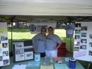 Crystal with board member Laura, at the Peace and Justice Fair sharing volunteerism stories.