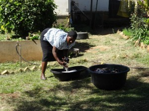 Auntie Agnes hand washing clothes at a Zambian Orphanage