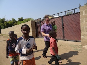 Walking with the children of OZ Kids International Orphanage.
