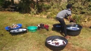 Washing without the washing machines at OZ Kids International Orphanage.