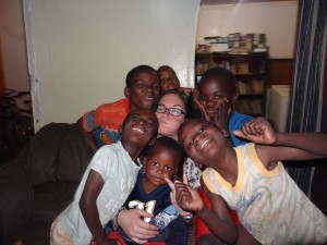 Crystal goofing off with the kids at an orphanage in Zambia.