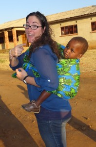 Crystal carrying little Lushomo on her back at an orphanage in Zambia.